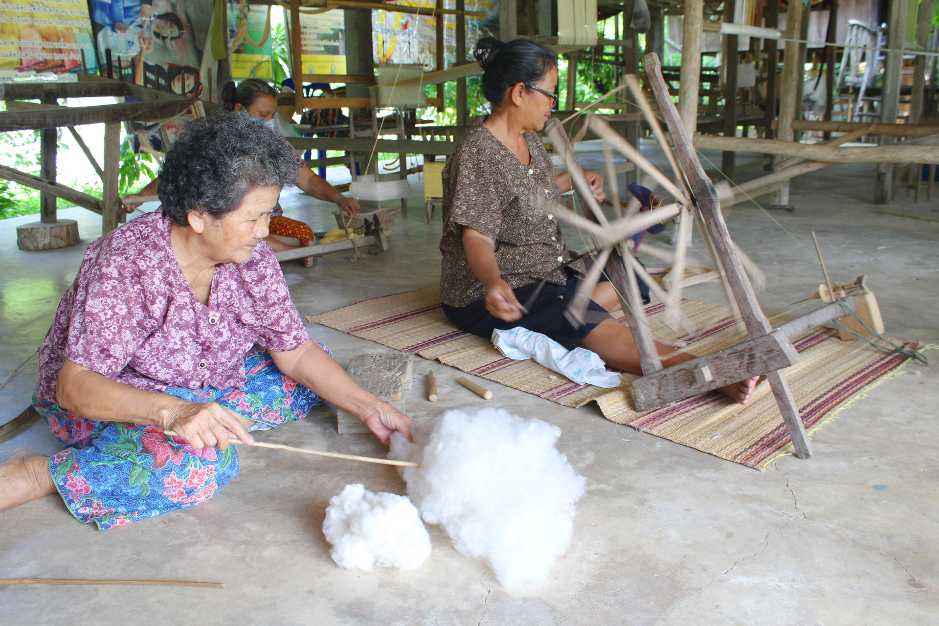 artisans preparing cottons before weaving