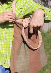 Hand-woven pleat lady hand bags with green and brown in an apricot handle